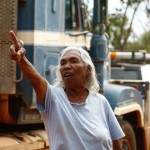 "Theresa Roe, mother of native title claimant Joseph Roe, tells woodside workers ""Take them back – please take them back today,"" MURRANJI PHOTOGRAPHY 2011"