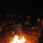 john sings around campfire