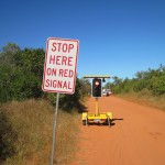 The first ever stop sign in the Broome area controls traffic past the idle drilling and clearing machinery